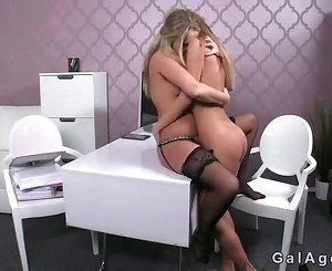 Two female agents kissing and licking in office