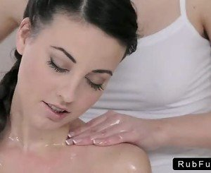 Blonde masseuse massages and fingers brunette