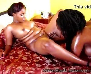 Bootylicious African babe takes care of a big boobed black lezzie