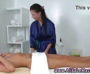 Horny lez masseuse gets frisky