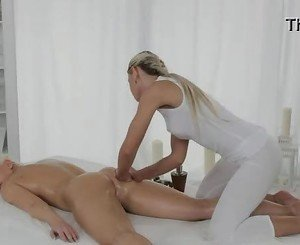 Blonde gets massage with tools on table
