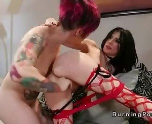 Goth lesbian babes fingering and strap on fucking